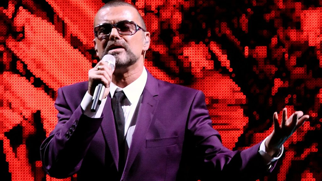 "FILE PHOTO British singer George Michael performs on stage during his ""Symphonica"" tour concert in Vienna September 4, 2012. REUTERS/Heinz-Peter Bader/File Photo FOR EDITORIAL USE ONLY"