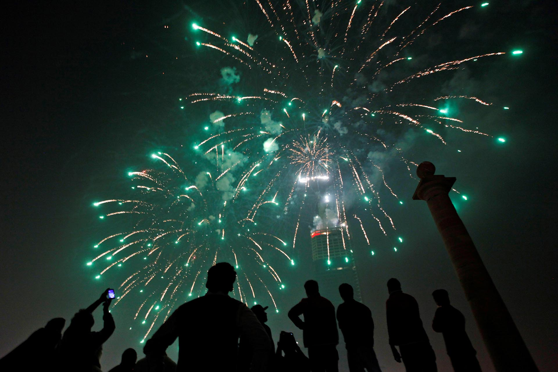 People gather to observe fireworks in celebration of the New Year in Karachi, Pakistan, January 1, 2017. REUTERS/Akhtar Soomro